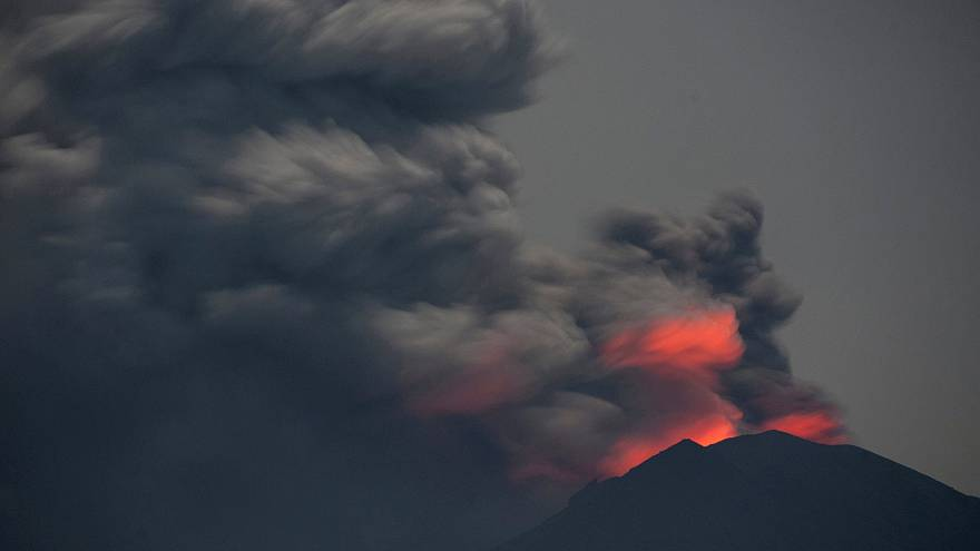 Mount Agung's mighty ash cloud hides rising molten lava