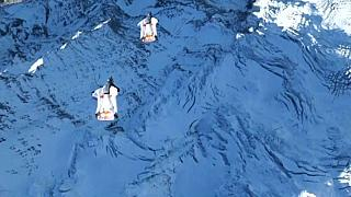 The daring stunt took place in the Swiss Alps