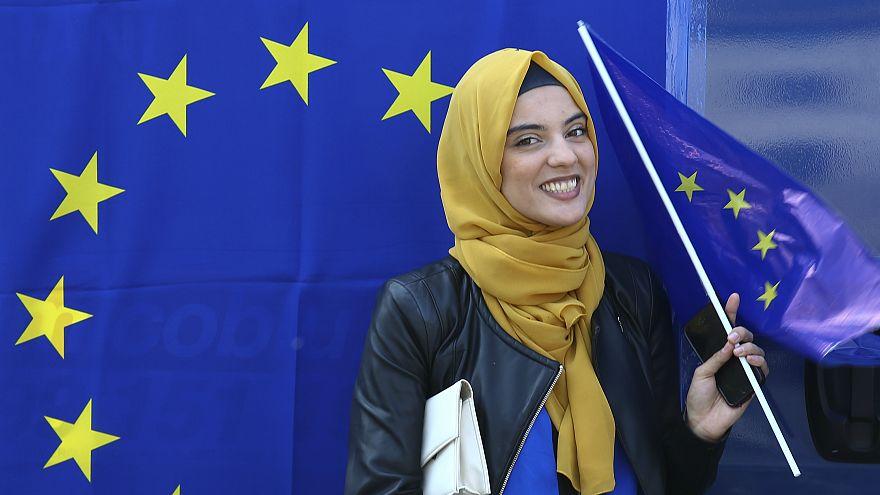A muslim woman holds an European flag during a pro-EU demonstration