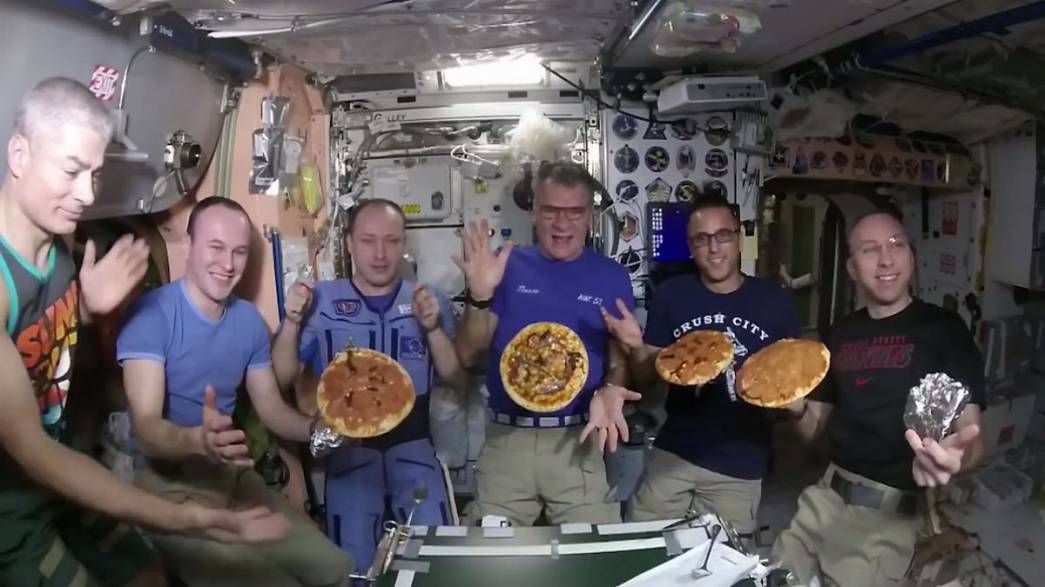 Watch: Italian astronaut Paolo Nespoli shares a pizza home with ISS crew