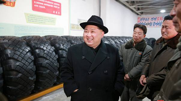 North Korea's leader Kim Jong Un inspects tyres at a factory
