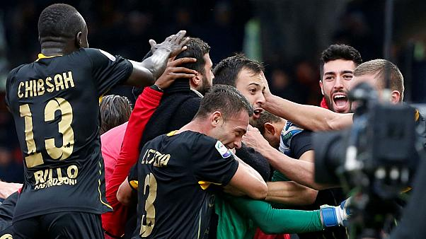 Alberto Brignoli celebrates with teammates after scoring goal