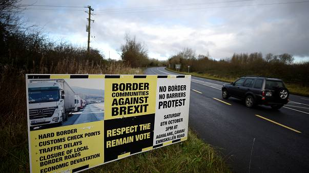 A sign from Border Communities Against Brexit is seen on the borderline bet
