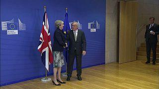 Theresa Merkel e Jean Claude Junker a Bruxelles