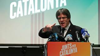 Ousted Catalan leader Carles Puigdemont gives a speech at the launch