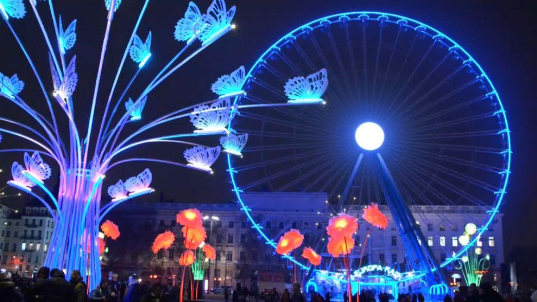 Light tricks dismantle a cathedral and show a spider invasion in Lyon's Fête des Lumières