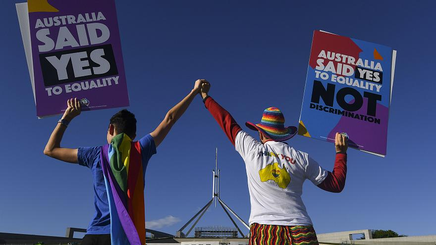 Same-sex marriage campaigners outside Parliament House in Canberra, Dec. 7