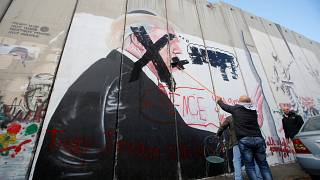 Mural depicting US President Trump in the West Bank city of Bethlehem