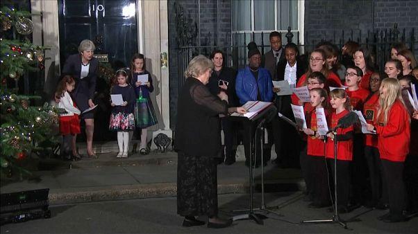 Theresa May singing carols