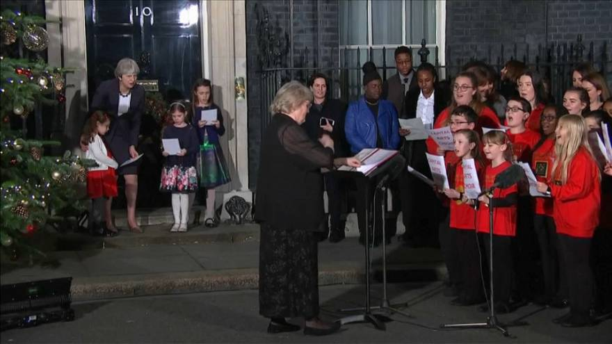 Theresa May singing carols
