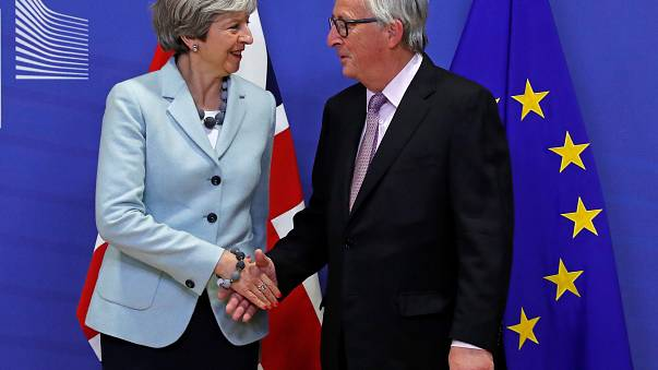 Theresa May is greeted by European Commission President Jean-Claude Juncker