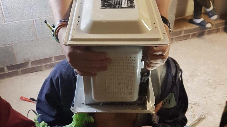 Firefighters free man from microwave