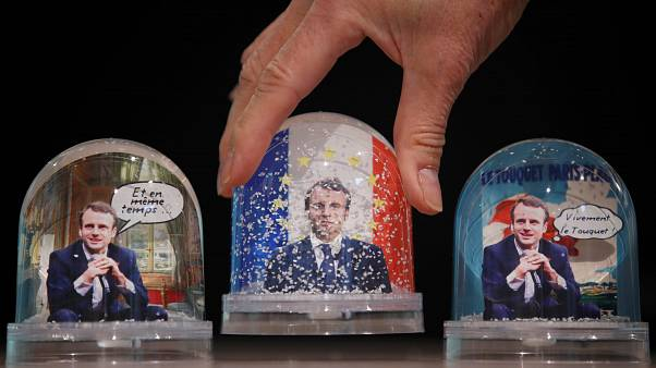 Snowglobes depicting French President Emmanuel Macron, made by Bruot compan