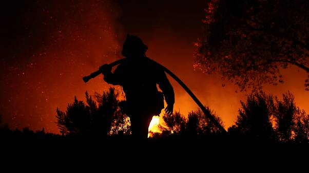Californian firefighters battle inferno - and fatigue
