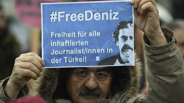 A protester demands the release of Deniz Yucel during a Hamburg rally
