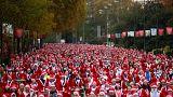 """Madrid e Berlino invase dai """"Babbi Natale"""""""