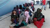 Migrants brought ashore by the Libyan coastguard