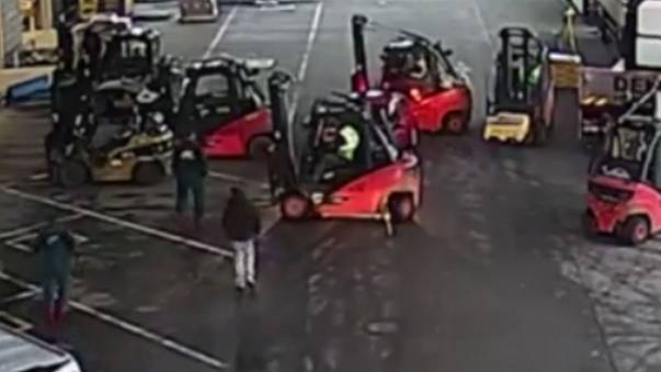 Watch: Warehouse workers use forklifts to block thieves' getaway