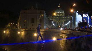Watch: tightrope walker crosses Rome's Tiber River