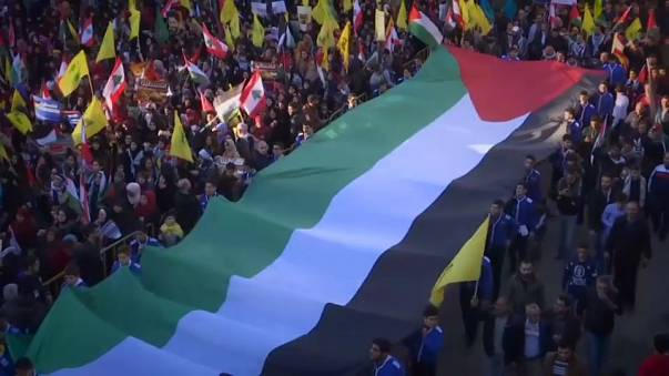 Hezbollah leader vows to return focus to Israel at rally in Beirut