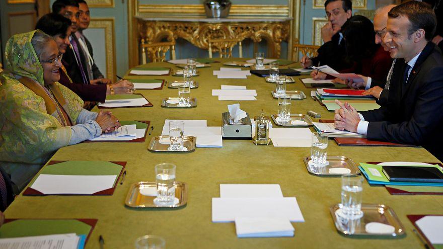 French President Emmanuel Macron (R) attends a meeting with Bangladeshi Pri
