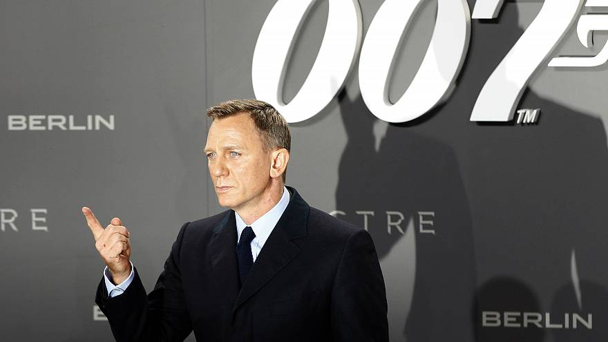 Actor Daniel Craig poses for photographers on the red carpet at the German