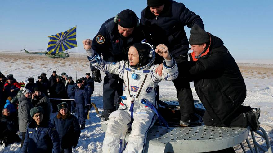 Three-man crew returns from space station