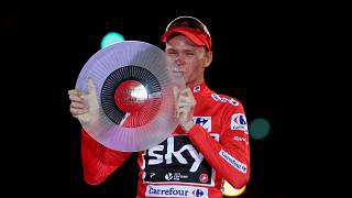 Froome posing with trophy