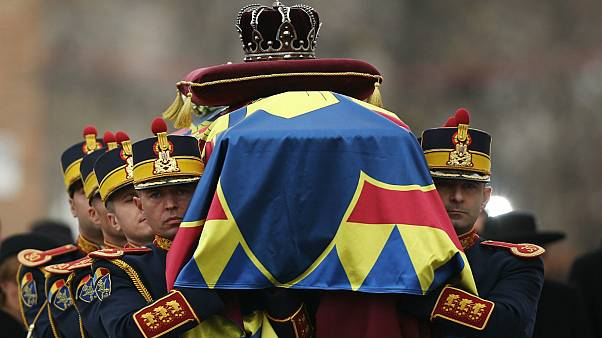 Soldiers carry the coffin of late Romanian King Michael during a funeral