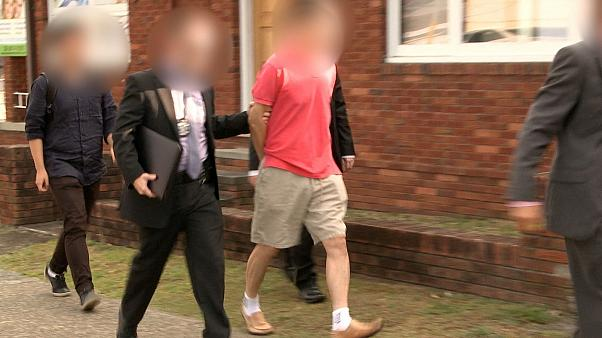 Australian Federal Police arrest a man during operation BYAHAUT
