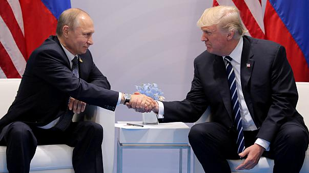 FILE PHOTO: President Trump shakes hands with President Putin in July