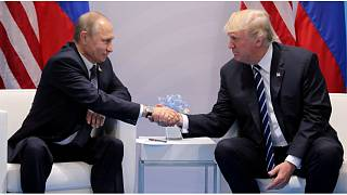 U.S. President Trump shakes hands with Russia's President Putin