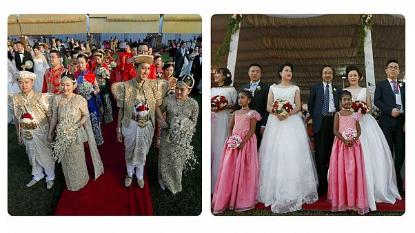Couples pose for photographs during a mass wedding ceremony