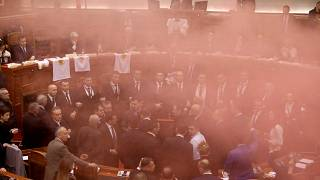 Albania's opposition lawmakers throw smoke bombs inside the Parliament duri
