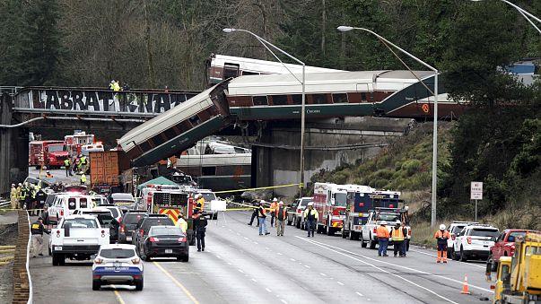 Three die as speeding train derails on highway bridge in Washington state