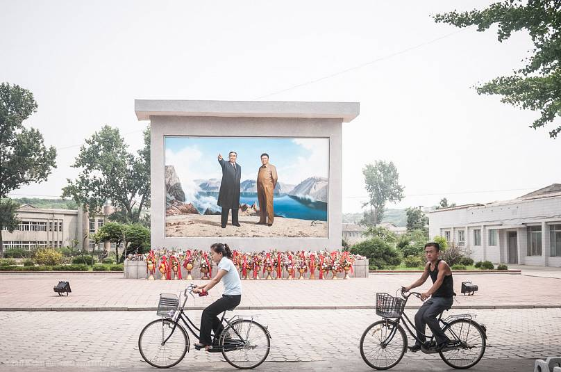 North Korean citizens on bikes