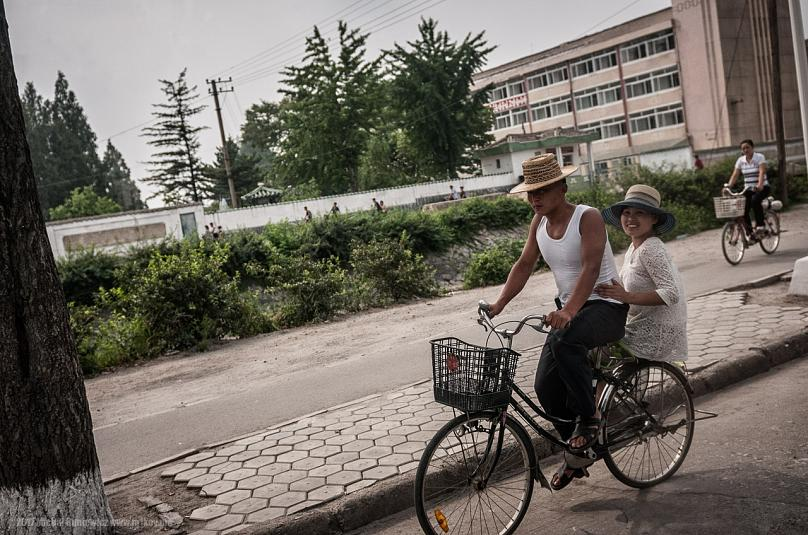 A North Korean couple on a bike