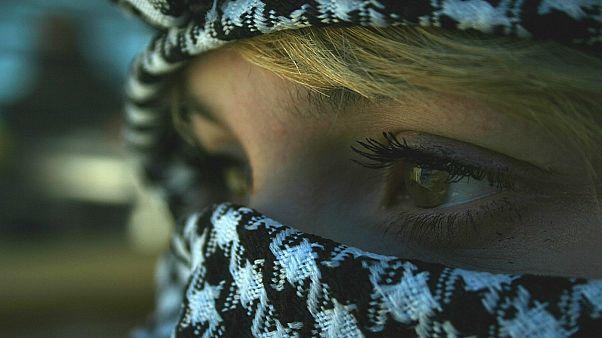 A Palestinian girl with a kaffiyeh