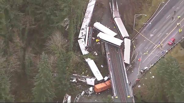 Investigators seek answers from crew of derailed Amtrak train