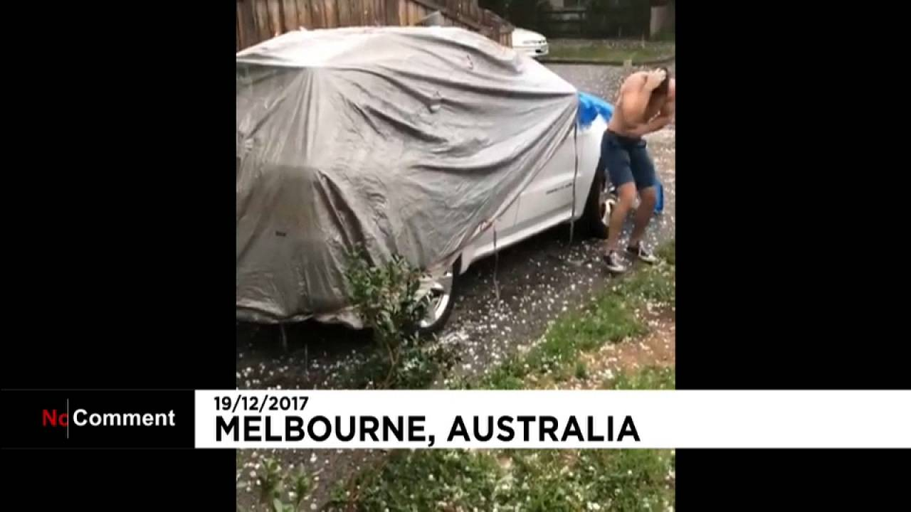 "A man seeks shelter from ""golf-ball"" sized hailstones in Australia"