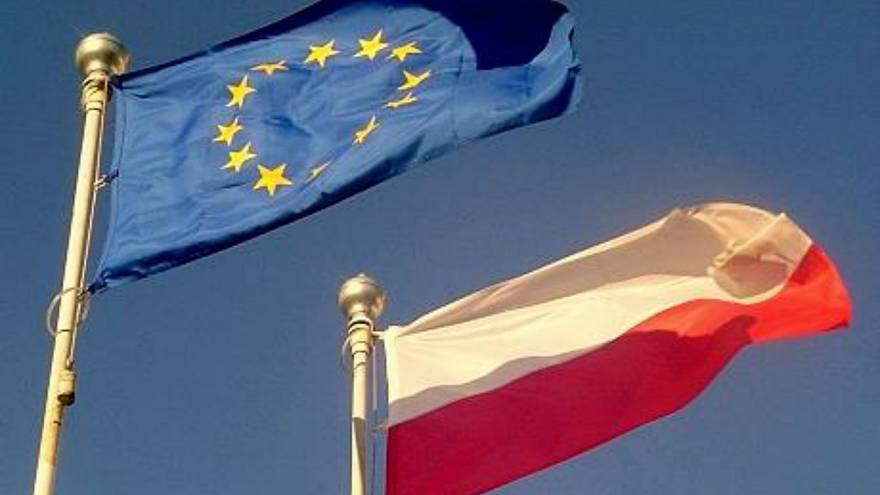 Flags of the European Union (upper left) and Poland (lower right)