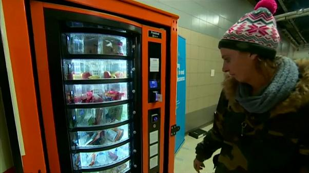 Homeless woman uses vending machine provided by charity
