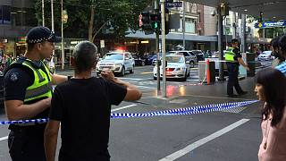 Police officers stand guard after arrest of the driver Melbourne