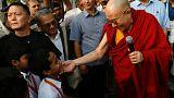 Tibetan spiritual leader, the Dalai Lama, speaks to students at a school in