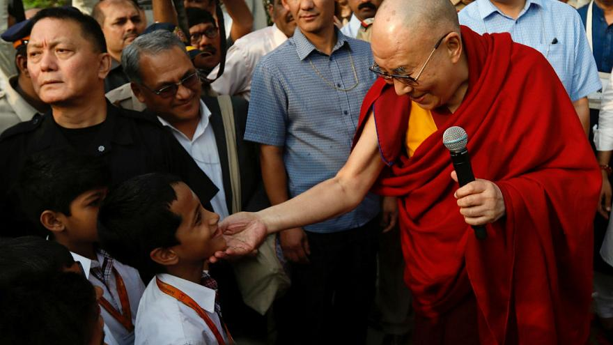 Tibetan spiritual leader, the Dalai Lama, speaks to students at a school in