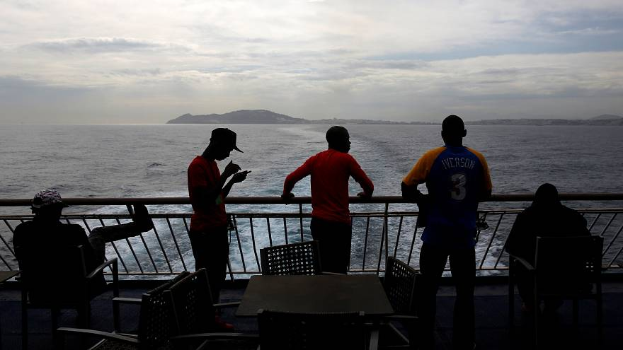 African migrant stand on board a ferry to Algeciras after having awaited