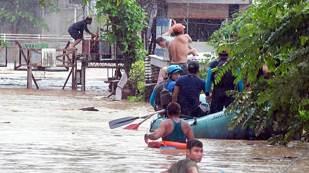 Rescuers evacute residents during heavy floodingin  Philippines