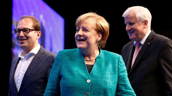 Angela Merkel accompanied by Alexander Dobrindt of CSU