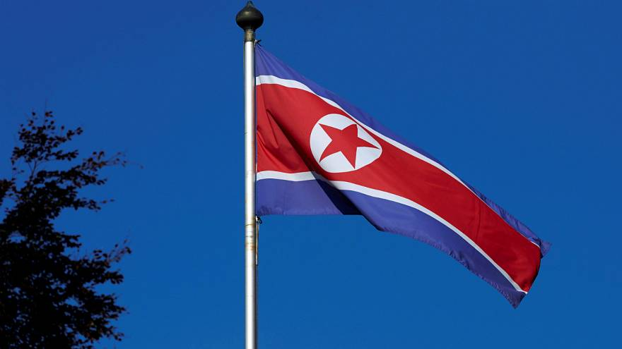 A North Korean flag flies on a mast at the Permanent Mission of North Korea