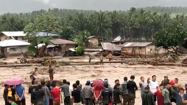 Philippine storm: Death toll of 200 expected to rise as rescuers search for victims